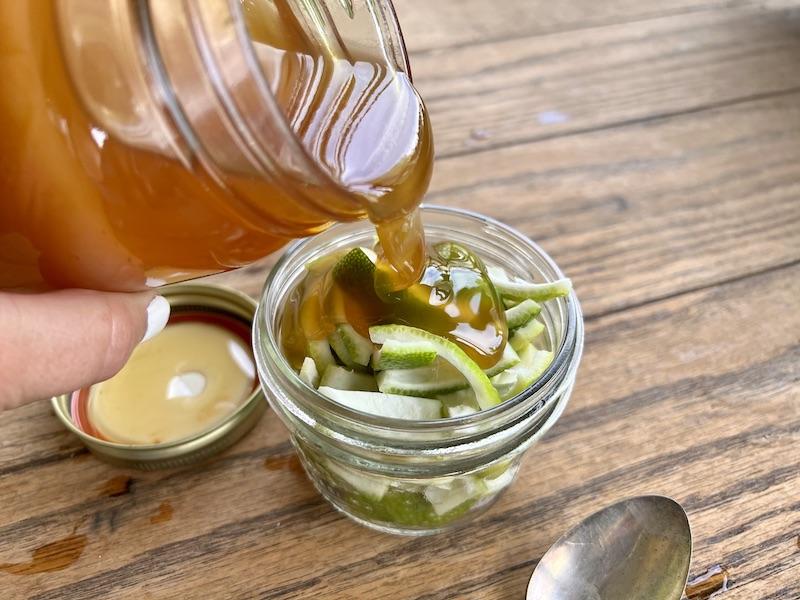 pouring honey on lemon